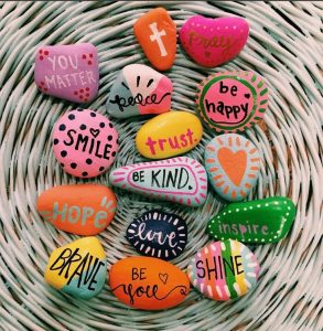 Paint inspirational rocks and leave them around your hometown