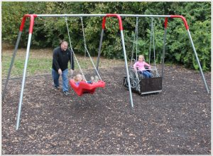 Add an ADA molded swing or platform swing to a park